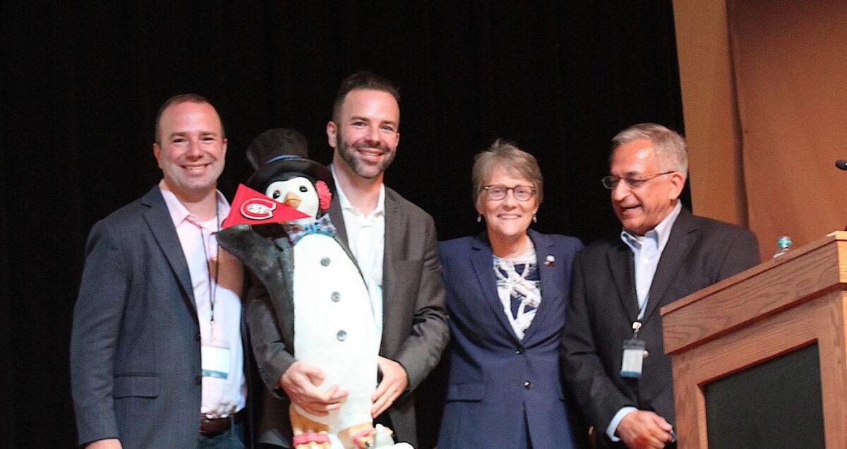 Managing Partners Rob Weber, Ryan Weber, and Pradip Madan with SCSU President Robbyn Wacker